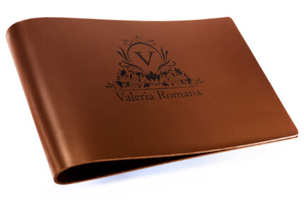 Laser Etching on Dark Tan Leather Binder