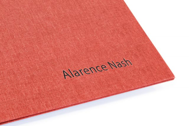 Black Foil Letterpress on Red Peach Cloth Screwpost Portfolio