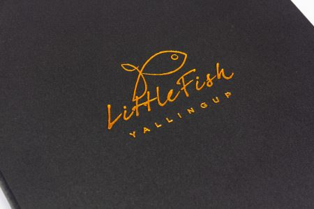 Hh A4 Prt Blk Little Fish Cloth Bronze Foil Logo