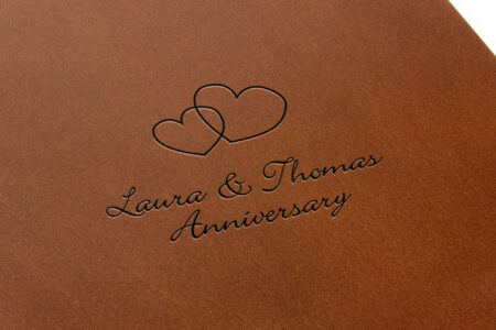 Lthr Pf 8.5x11 Prt Dark Tan Laura & Thomas Anniversary Laser Etch Closeup