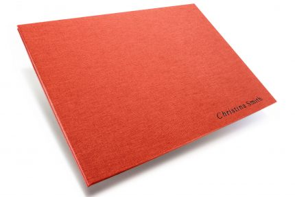 Black Foil Letterpress on Red Peach Cloth Portfolio